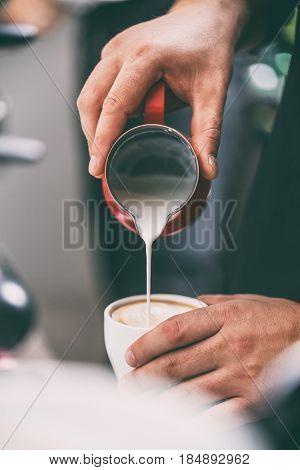 Brista Adding Milk To Coffee