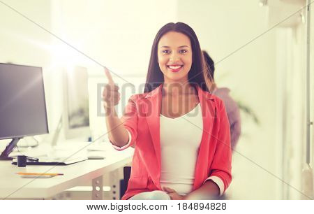 business, startup, gesture, success and people concept - happy young african woman with computer working at office showing thumbs up