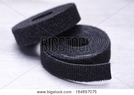 Roll of Velcro Tape on Gray Metal Surface