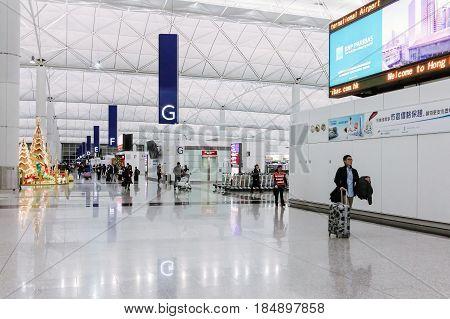 Hong Kong - December 28 2013: Hong Kong International Airport (Chek Lap Kok Airport) Terminal 1 at night-time after Christmas Day
