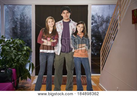Brother and sisters standing in entryway together