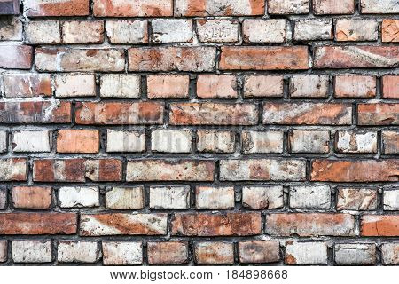 Colorful irregular brick wall texture or background.