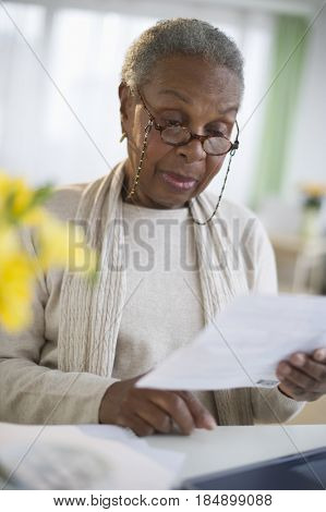 Black woman reading letter