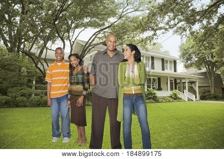 Family standing in yard together