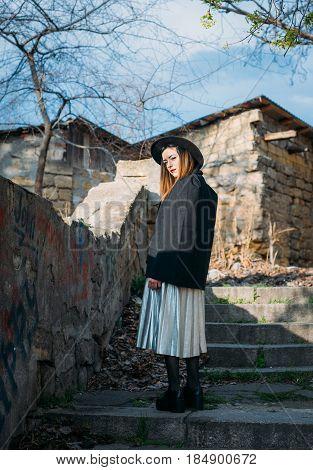 Fashion Pretty Woman Model Wearing A Balck Hat And A Black Jacket