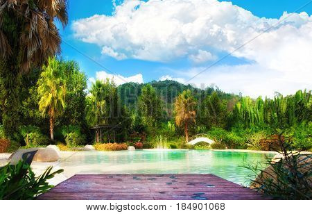 View of sandy beach pond with forest around. Thailand Phuket