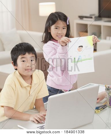 Korean children with laptop and drawing