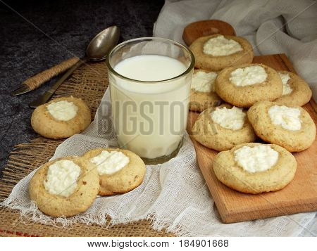 Healthy Peanut Butter Cheesecake Thumbprint Cookies. Delicious Homemade Shortbread And Glass Of Milk