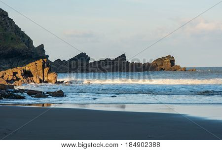 Small sandy bay and rocky coastline at North Devon England