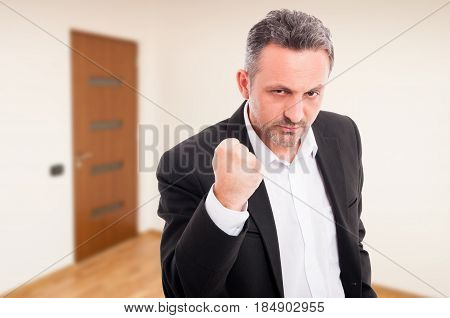 Angry Realtor Threaten With A Fist Rised Up