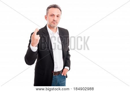 Serious Businessman Holding His Finger Crossed