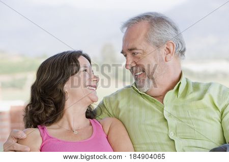 Chilean couple hugging outdoors