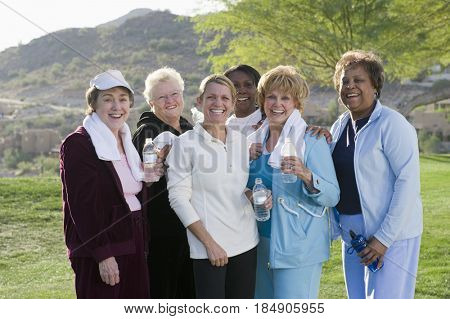 Exercise teacher standing with women outdoors