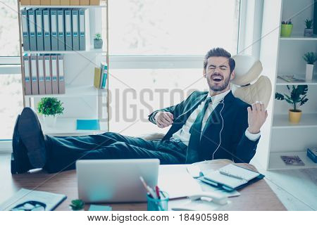 Be Whatever You Want To Be! Young Worker In Suit With Legs On The Table Listening To Music And Playi
