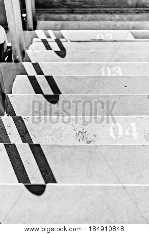 Close Up View Of Stadium Stairs With Numeration, Black And White