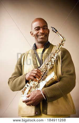 Black musician holding saxophone