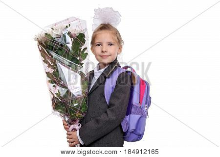 First grader with a bouquet of flowers.Joyful girl first goes to school to learn.