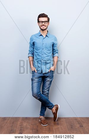 Full Size Vertical Portrait Of Cheerful Brunet Young Man In Casual Stylish Wear. He Looks At Camera