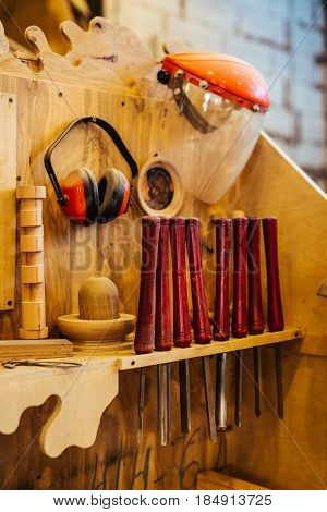 Background image of woodworking shop: wood cutting tools on workstation in empty carpenters studio