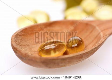 Fish Oil Omega 3 Gel Capsules In Wooden Spoon