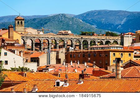 Segovia, Spain. Aerial view of old town Segovia, Spain with snowy mountains and old aqueduct