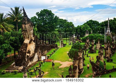 Vientiane, Laos. Famous Buddha park in Vientiane, Laos with numerous Buddha statues. Cloudy day in summer