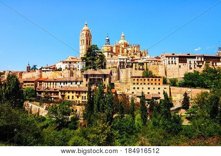 Segovia, Spain. Aerial view of old town Segovia, Spain with clear blue sky and old Cathedral