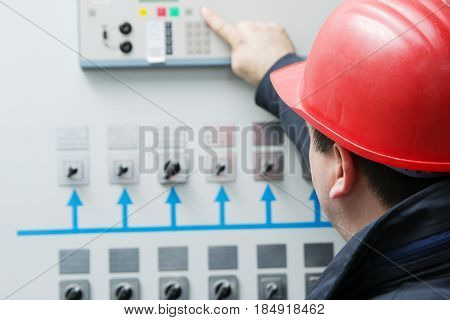Engineer give command in power plant control center