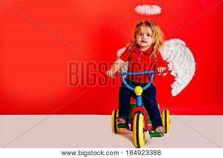 Angel Boy For Valentine Greeting, Beautiful Cupid On Bike