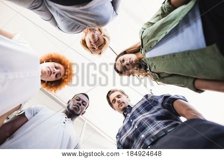 Directly below portrait of business people standing against ceiling in office