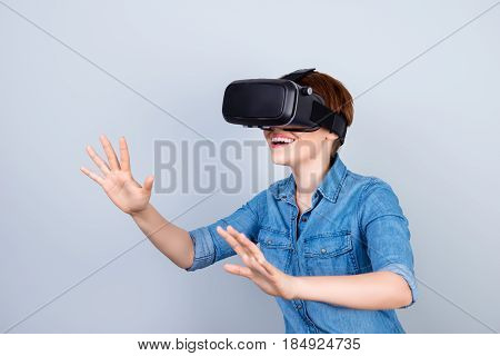 Happy Young Girl Is Using Vh Headset Glasses Of Virtual Reality, Touching Something With Her Hands L