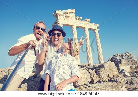 Funny family take a selfie photo on Apollo Temple colonnade view in Side Turkey