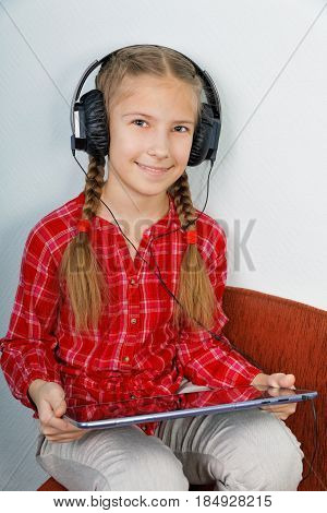 Pretty girls listening music on tablet PC