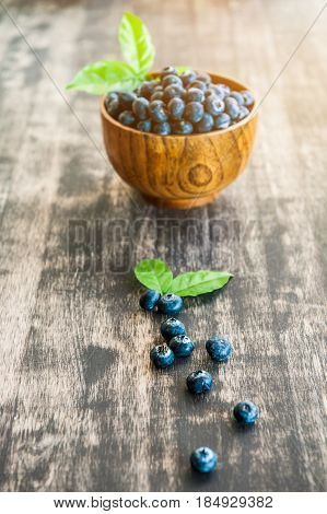 Blueberries On Wooden Background, Freshly Blueberries In Wooden Bowl. Juicy And Fresh Blueberries Wi