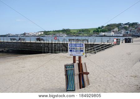 Swanage Dorset United Kingdom -23 April 2017: Deckchairs for hire on Beach