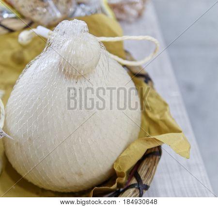 Provola(fiaschetto) italian cheese at market , italy