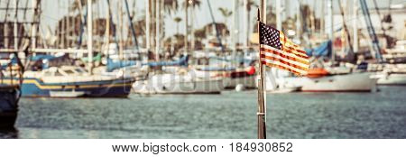 A flag on the back of a boat in a southern California marina.