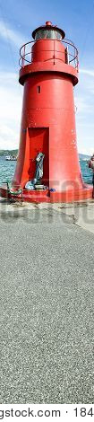 detail of red light house in the harbour of la spezia