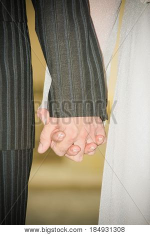 Young married couple holding hands ceremony wedding day