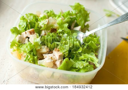 Preparation Of Hawaiian Salad. Chopped Ruddy Chicken Breasts With Leaf Salad, Pieces Of Pineapple An