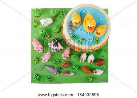 birthday cake with farm marzipan animals and number 3 isolated on white background