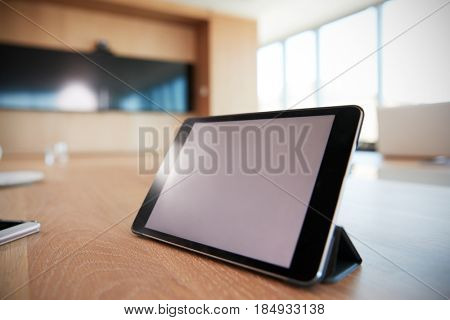 Digital Tablet On Empty Boardroom Table In Office