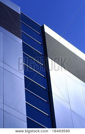 Modern office building reflecting the sun.