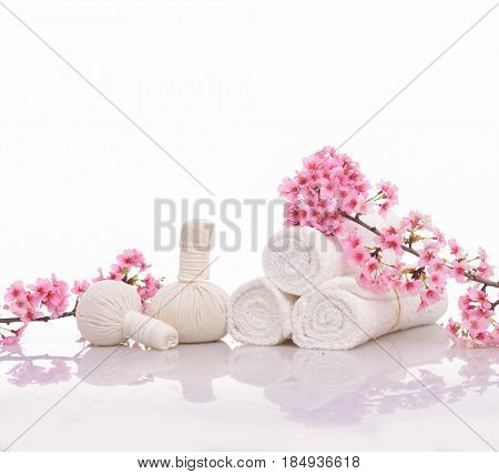 Spa treatment with blooming branch cherry ,ball,towel on white background