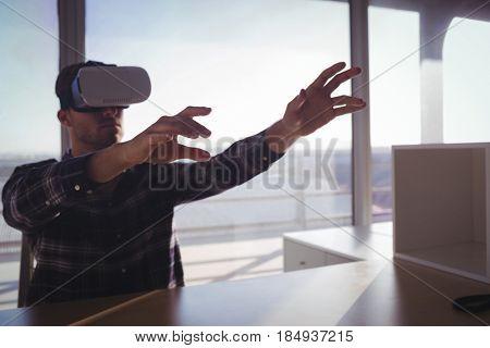 Entrepreneur testing virtual reality technology at office