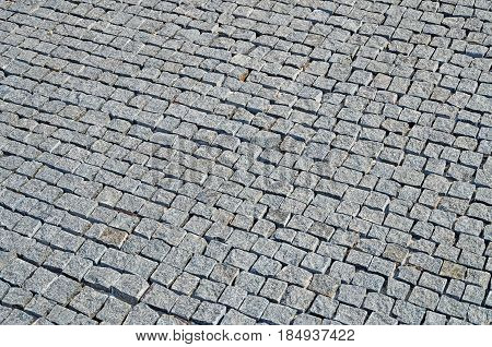 Freshly laid granite paving stones on a city roadway on a sunny day