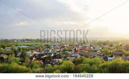 Individual houses on the outskirts of the city in the evening.