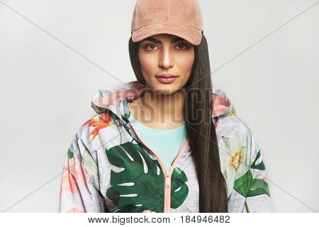 Woman In Sports Jacket And Cap