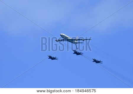 air Force parade in the sky of Israel Airplane tanker and combat aircraft fighter-bombers