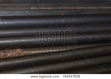 Pile Of Cylindrical Old Rusty Iron Steel Bars